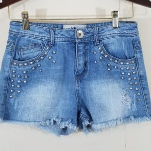 Distressed cut off jean shorts with studs size 5